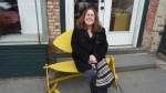 Jolie in a funky yellow seat on the street